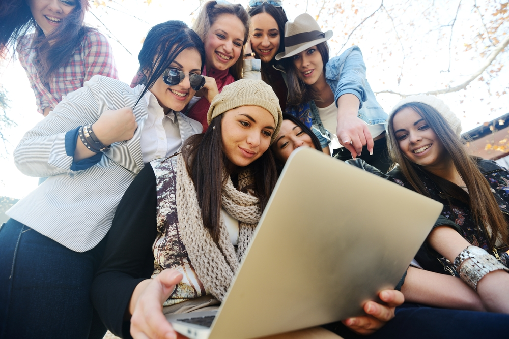 image of young girls looking at small business website design